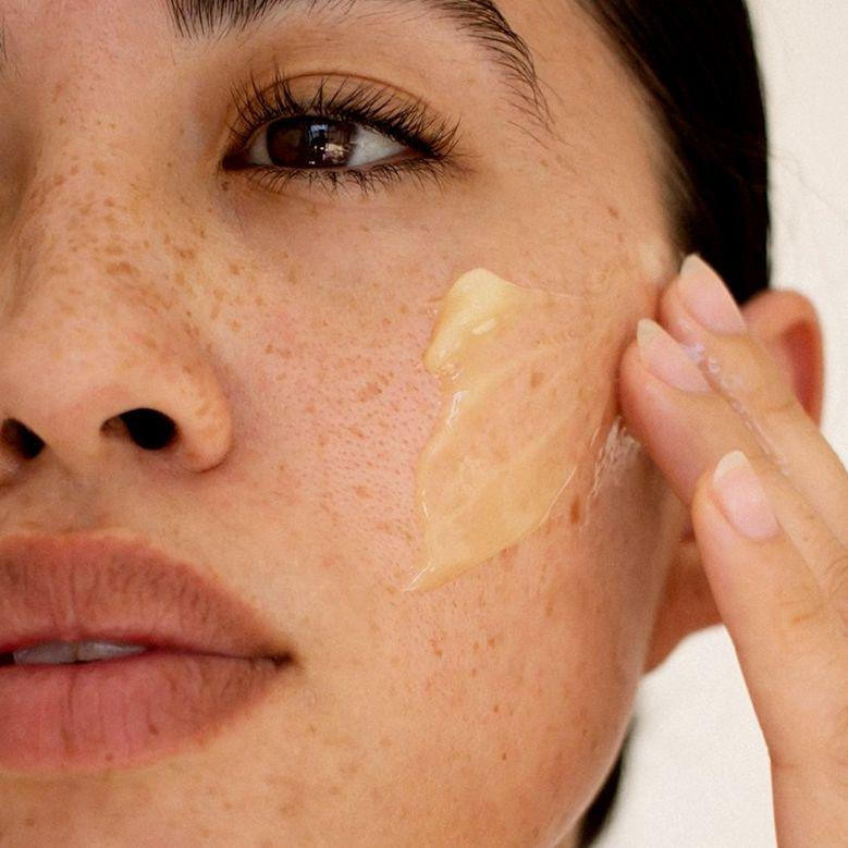 closeup of person applying moisturizer