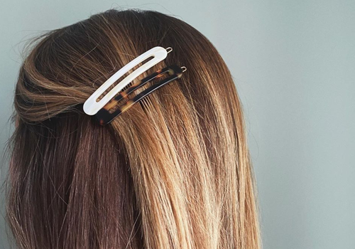 light brown hair with two hair clips detangled
