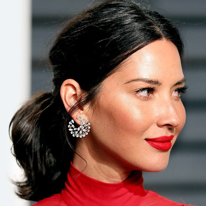 Olivia Munn with a short messy ponytail
