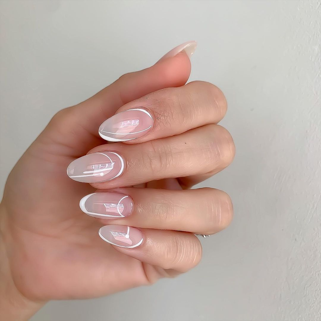 Person with milky abstract line nails