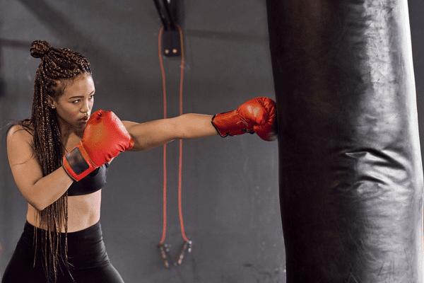 woman hitting punching bag