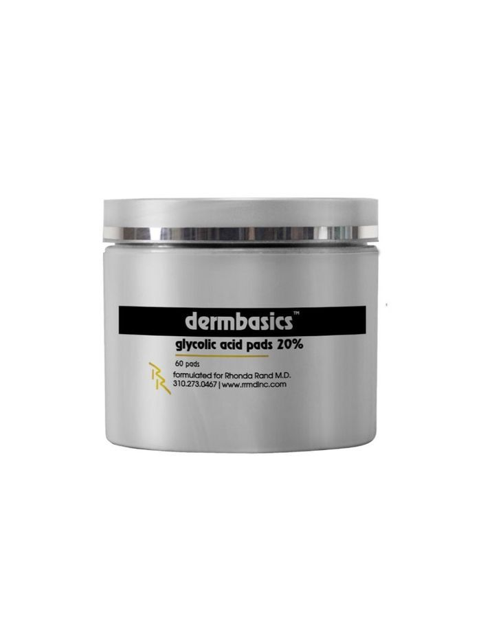 A gray container of glycolic acid pads with black and yellow writing.