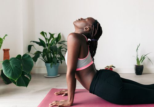 woman doing pelvic floor stretch
