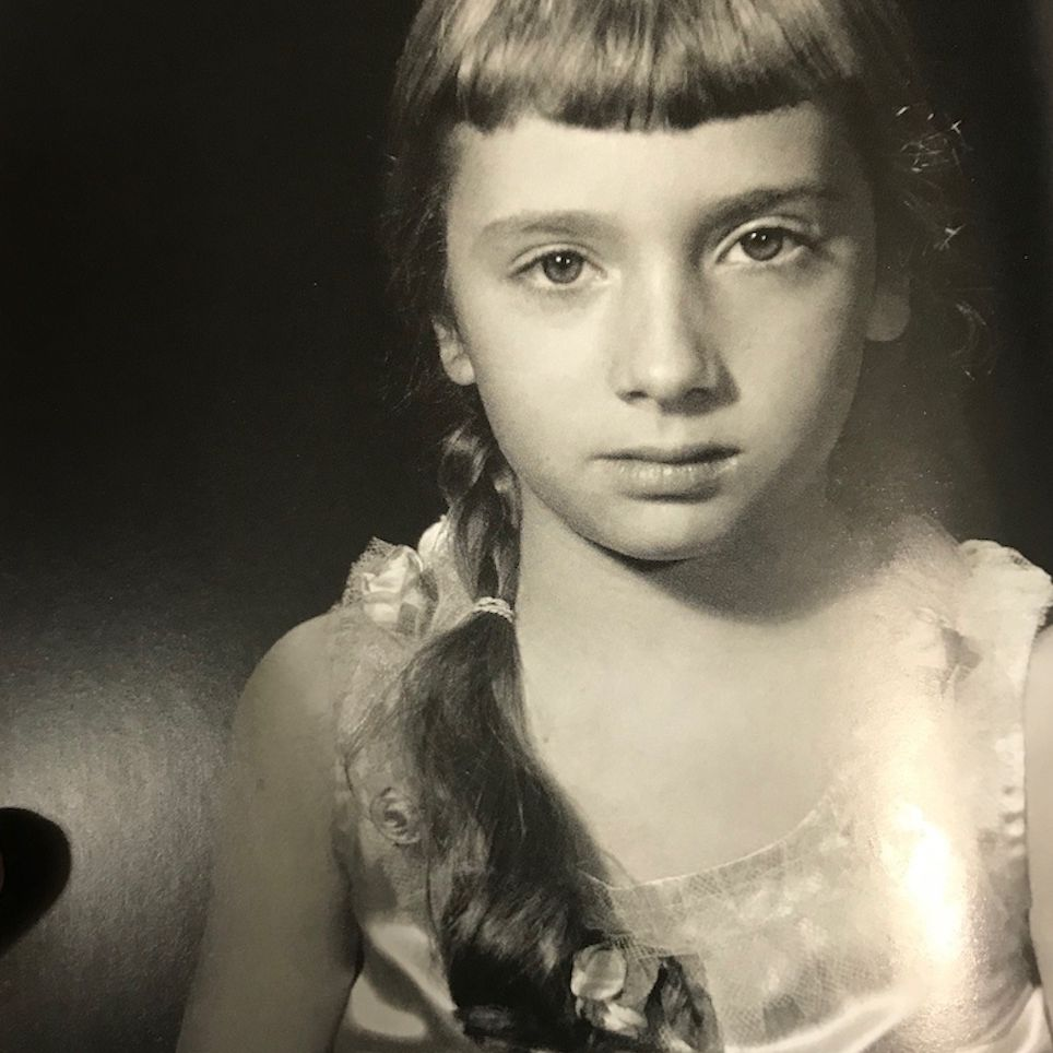 Vintage photo of a child with short bangs