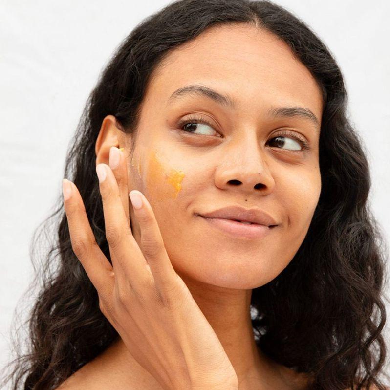 person applies elemis cream