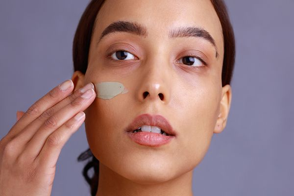 person applies clay face mask