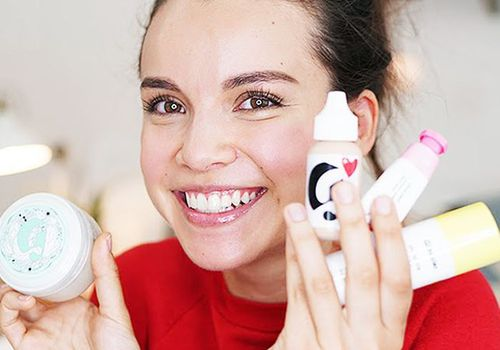 woman holding skincare products