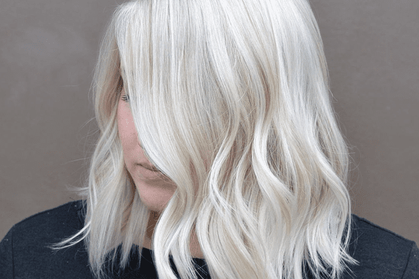 woman with white blonde hair looking down