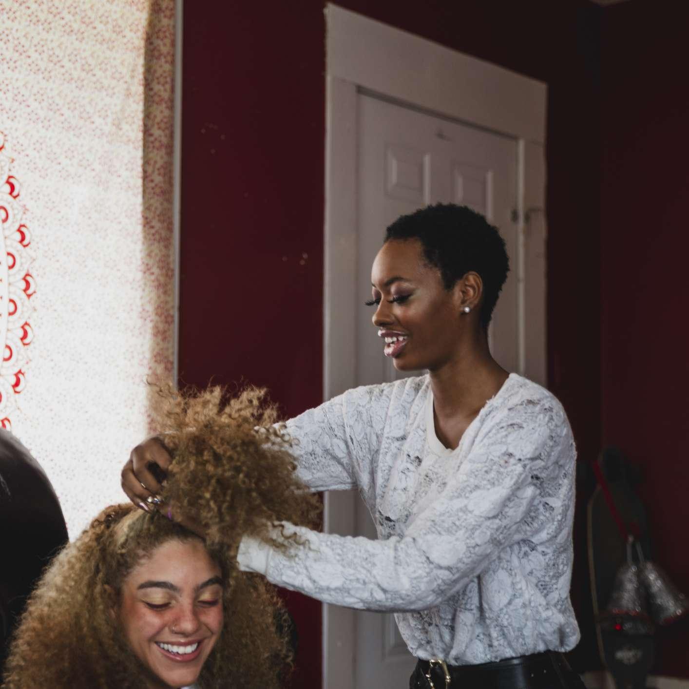 young women doing hair