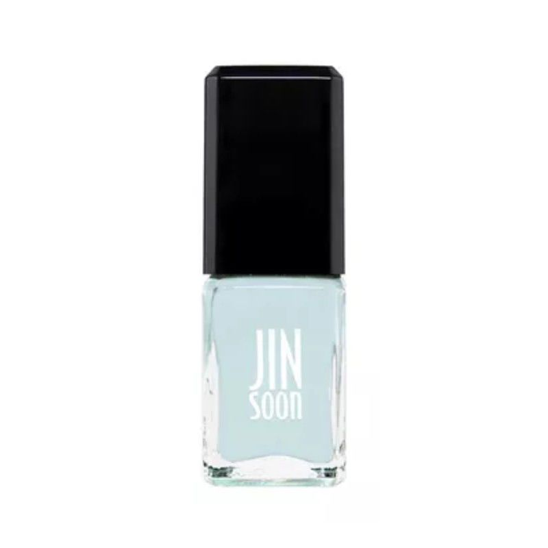 Bottle of pale blue nail polish with a black lid.