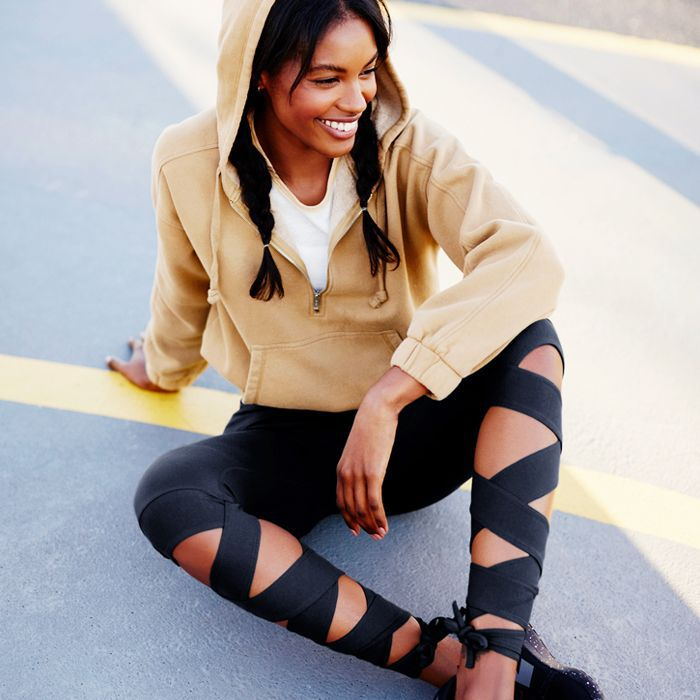 Woman sitting on the ground in leggings