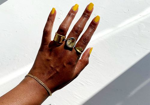 hand with squoval nails and gold rings