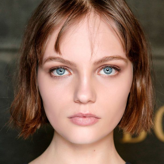 Woman with minimal makeup and short hair