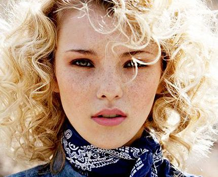 Woman with a blonde curly bob