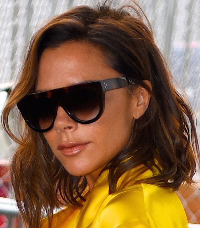Victoria Beckham Hair: Victoria Beckham in yellow dress and sunglasses