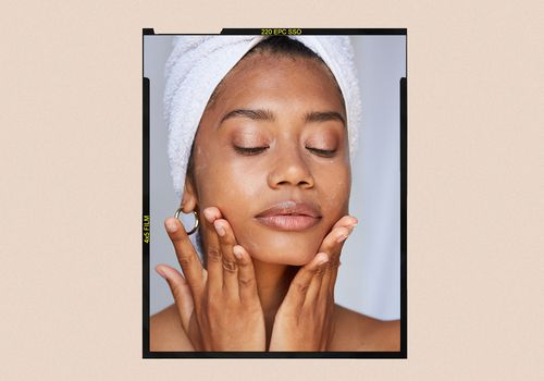 Woman with hands on jawline, applying facial treatment