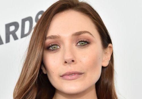 elizabeth olsen with smokey eye makeup and nude lip