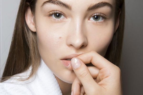 brunette woman with healthy nails