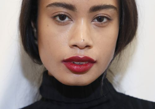 model with red lipstick backstage at NYFW