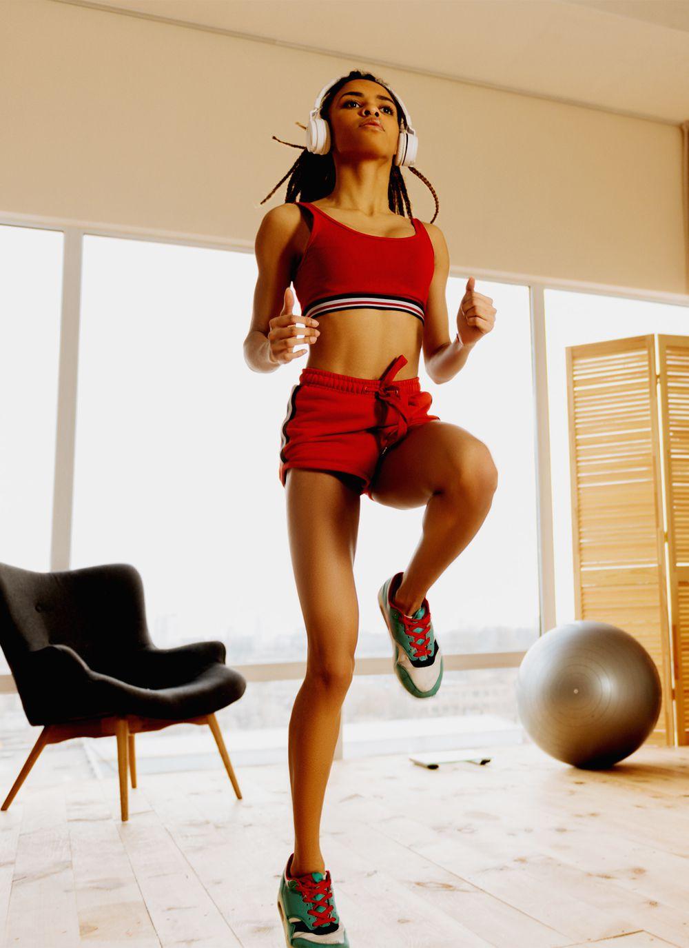 black femme doing morning workout inside