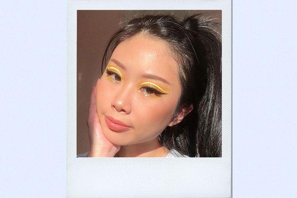 woman wearing yellow eyeshadow liner