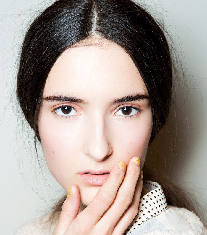 Model with subtle rosy eyelids and cheeks