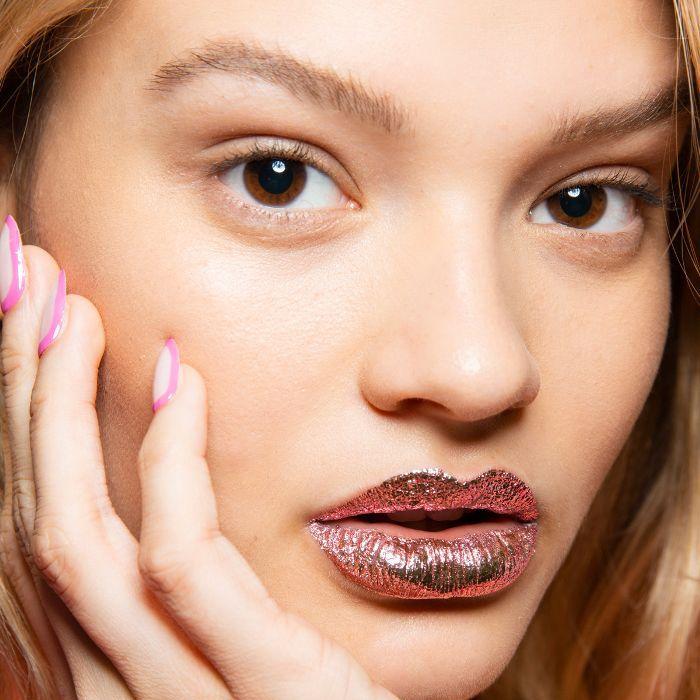 Model wearing rose gold lip foil on her lips