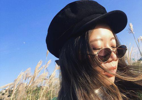 editor faith xue in flower field