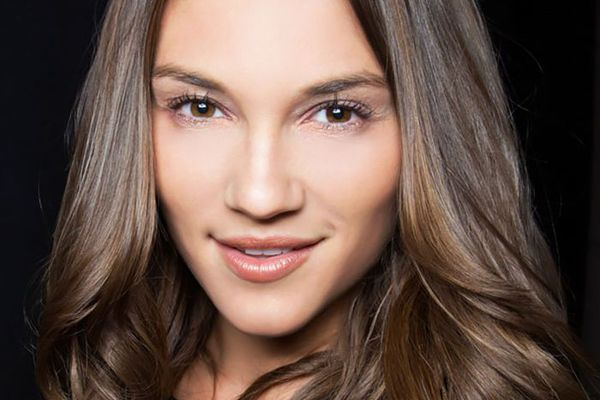 Woman with luscious long medium-brown hair