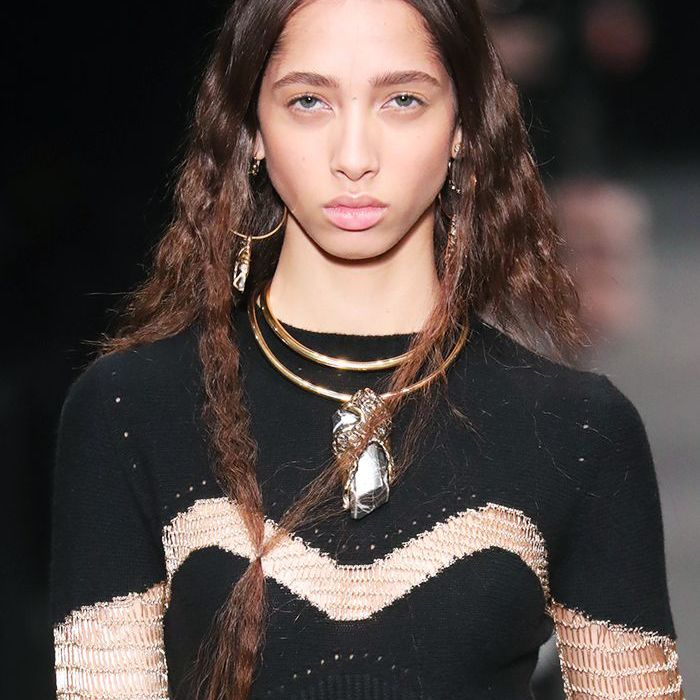 Crimped hair: model with crimped hair at Alexander McQueen autumn winter 2017
