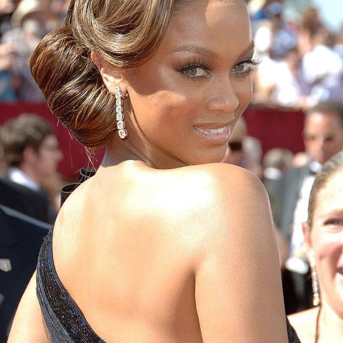 Tyra banks with a side chignon
