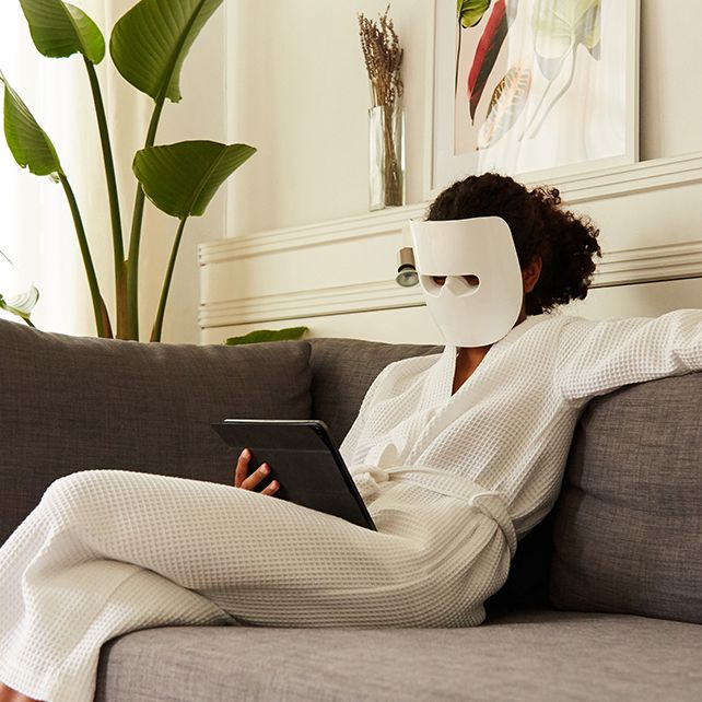 person doing at home light therapy
