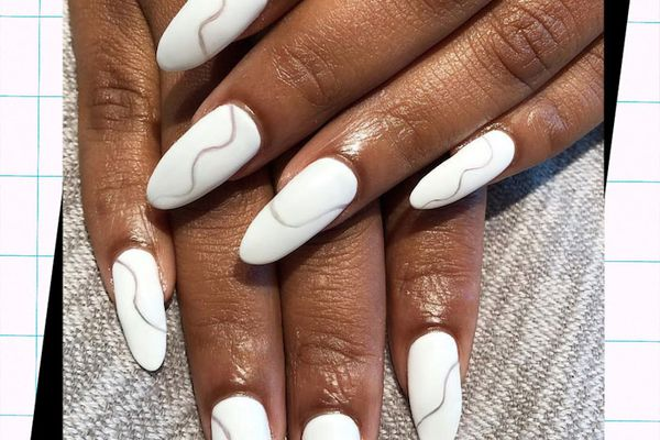 woman with short almond nails