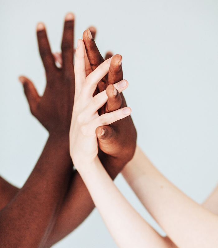 black and white hands intertwined