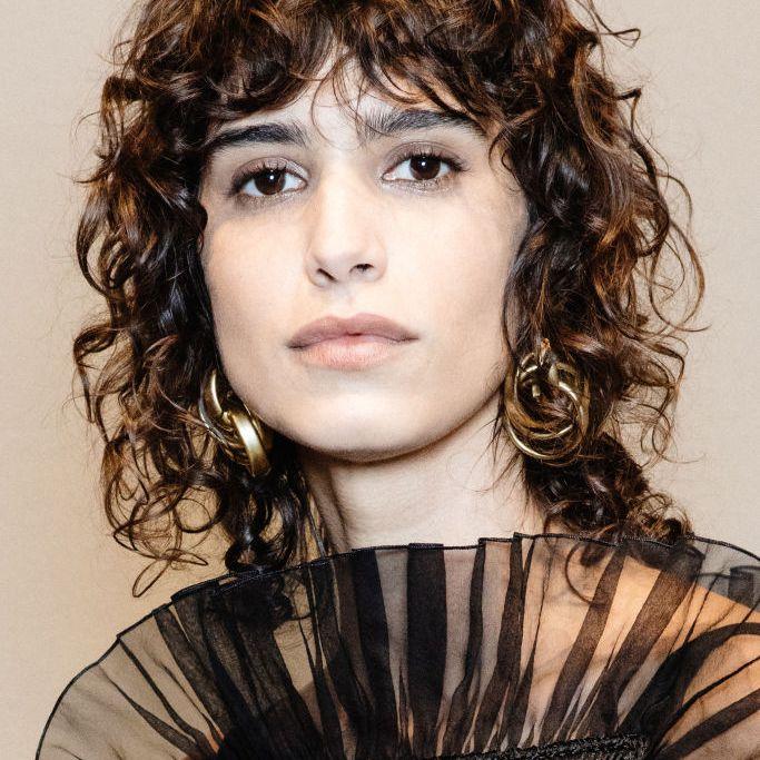 Mica Arganaraz curly shag with bangs