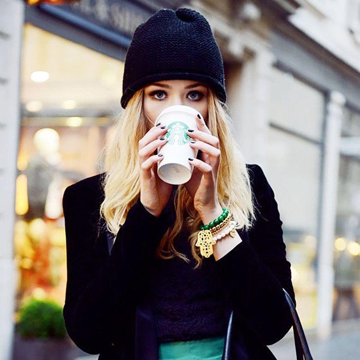 Woman drinking Starbucks drink