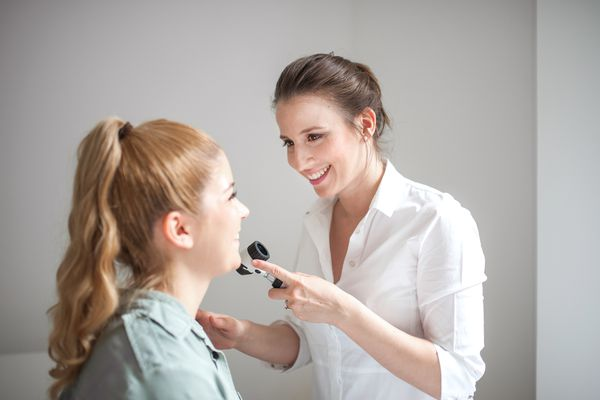 Dermatologist looking at a patient's skin