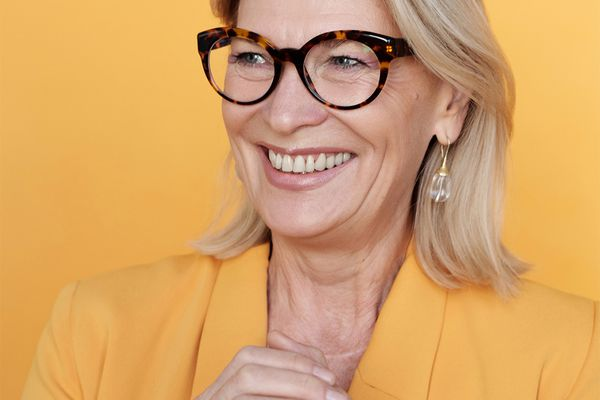 senior woman portrait in yellow