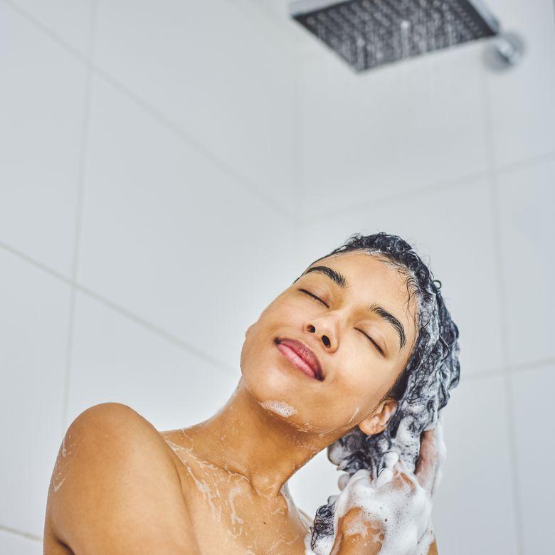 Woman using shampoo