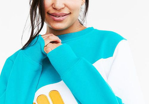 girl with tucked back hair nose ring and blue sweatshirt