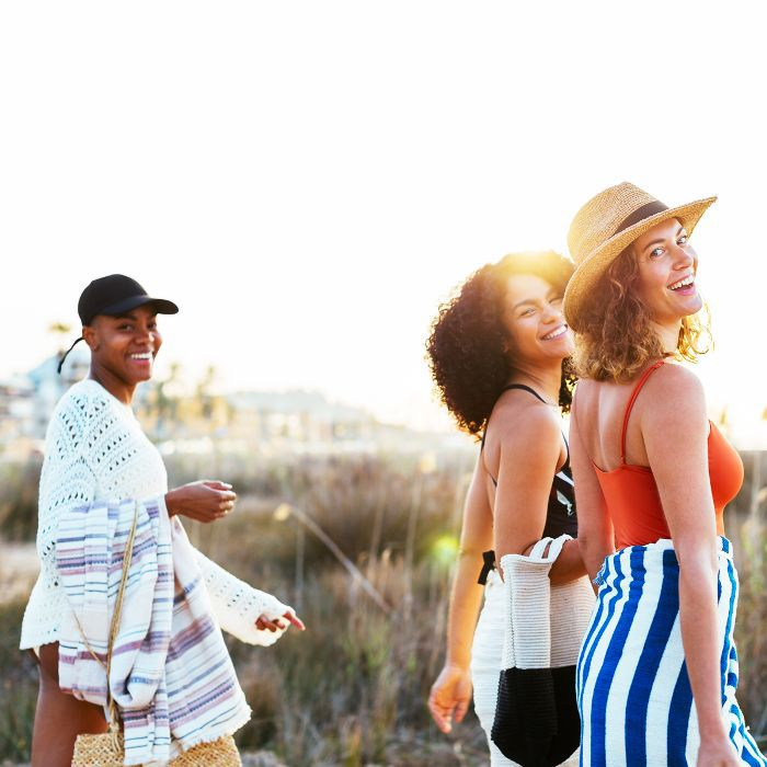best drugstore sunscreen: women heading to the beach