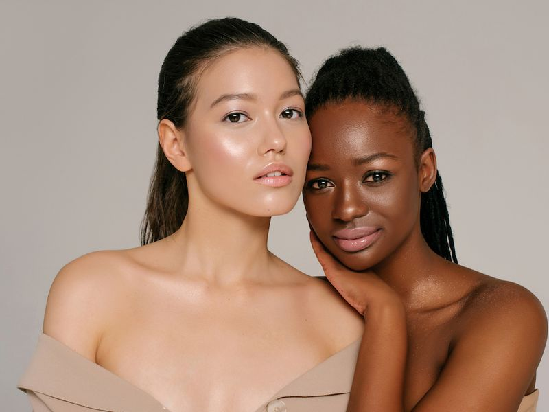 Two young women in nude colored makeup