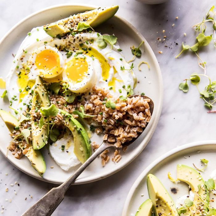 A dish of eggs, avocado, and grains represent a low-carb vegetarian meal