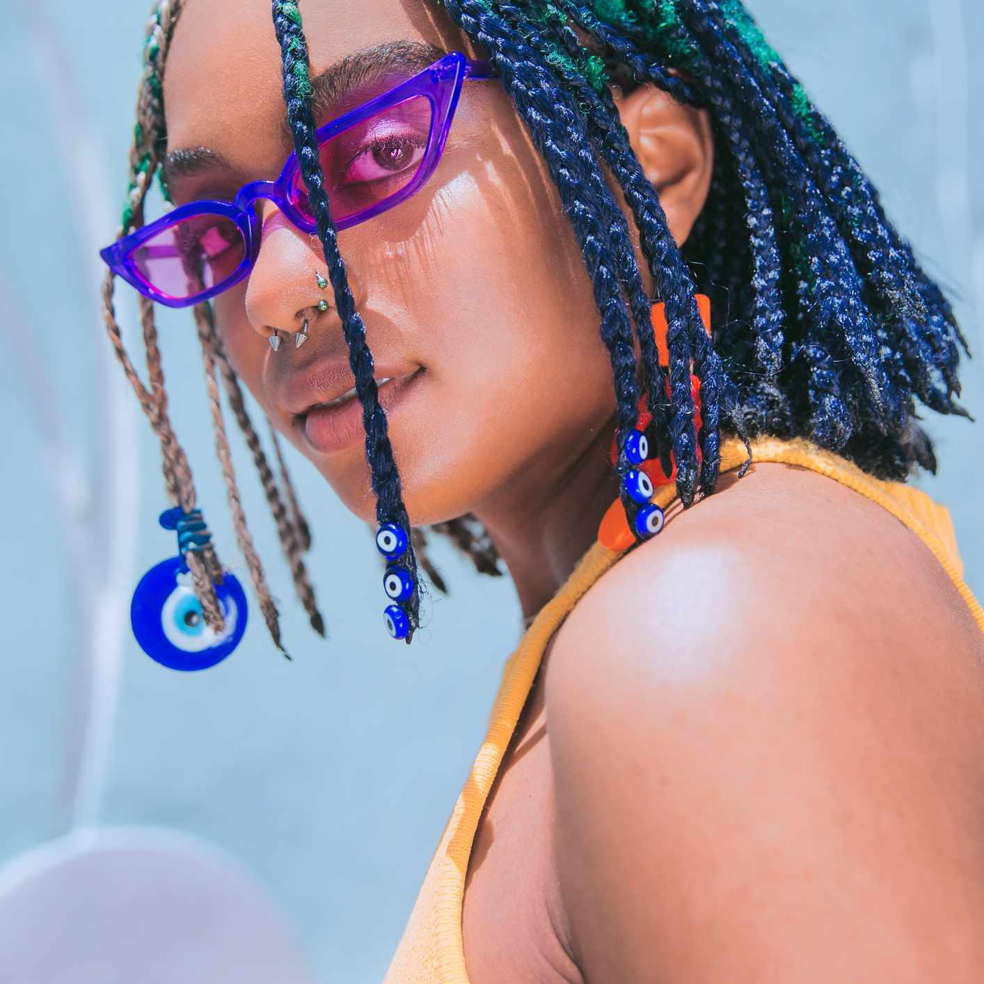 young woman with colorful hair and accessories
