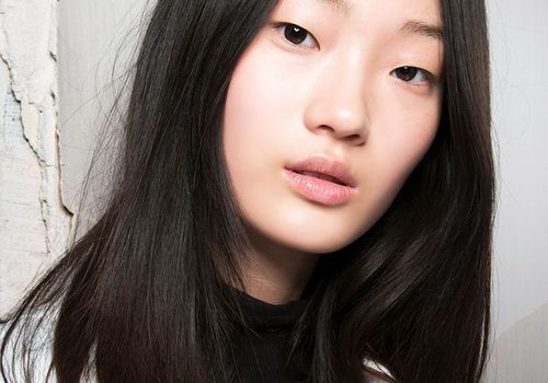 asian woman with little makeup on