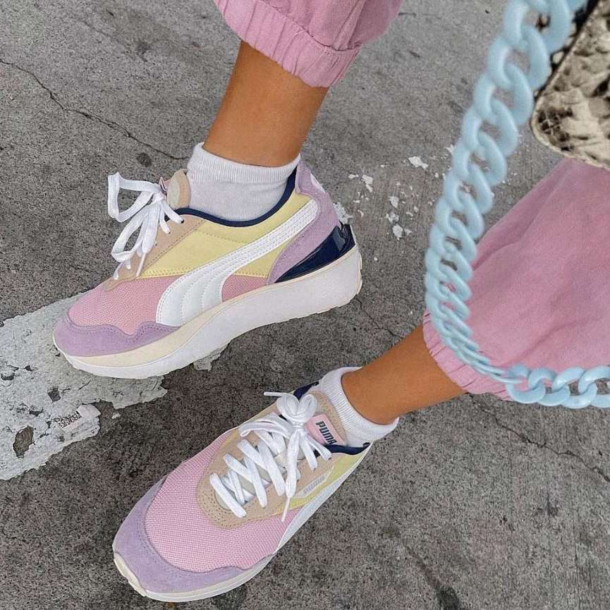 person wearing puma sneakers