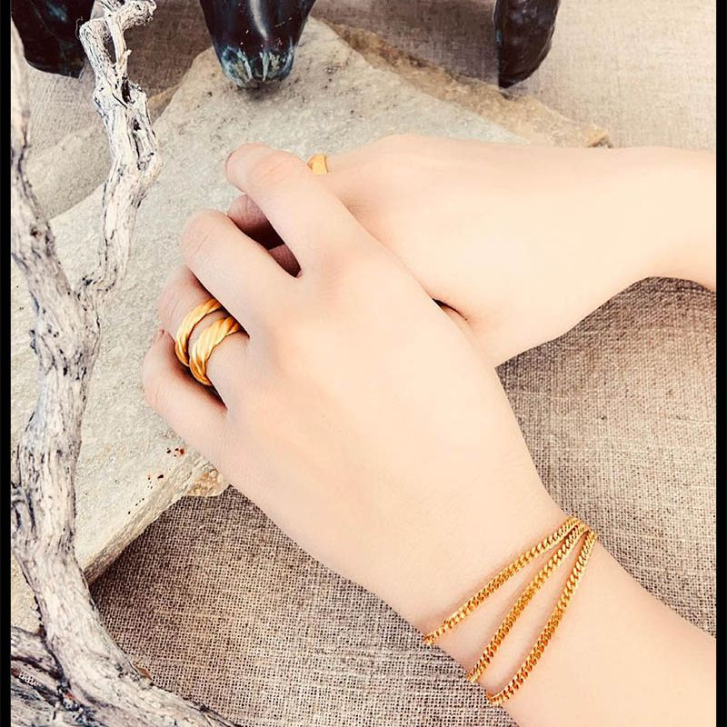 Woman wearing generation collection jewelry