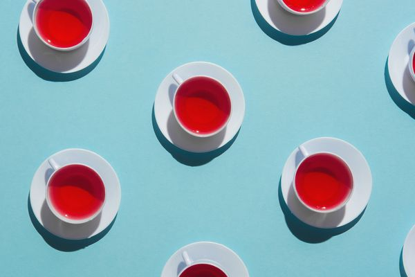 cups of tea on blue background
