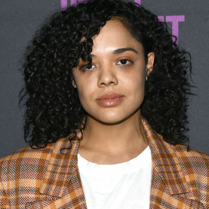 Tessa Thompson curly natural lob with side bang