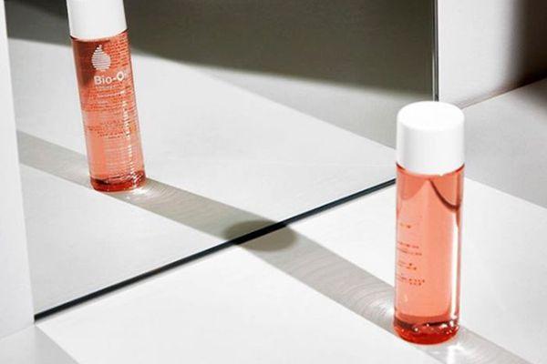 Bottle of bio-oil in mirror
